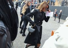 Christine Centenera in Proenza Schouler with a Chloé bag, black double breasted goat with patterned tights.