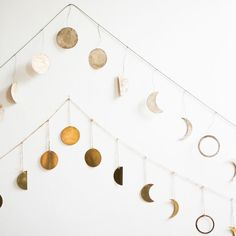 Welcome the magic of the lunar cycle into your home with one (or both!) of these gorgeous moon garlands. Each pendant has a lovely patina that's reminiscent of the real moon's natural shadows. Makes a #bedroomdesign