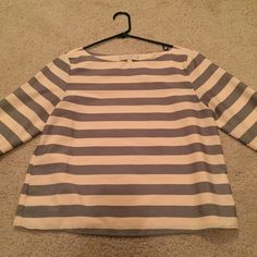 Super cute striped blush and grey blouse This blush and grey blouse is so chic and cute! It is 7/8 sleeve, but if buttoned up, it can be 3/4 sleeve! Just like new, in great condition! It is a petite size, so the length is a tad shorter than typical blouses in my opinion! Banana Republic Tops