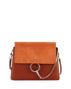 """Chloe soft leather shoulder bag. Pale golden and silvertone hardware. Removable, adjustable shoulder strap, 12"""" drop. Suede flap top with chain-clip and ring detail. Divided interior with suede lining"""