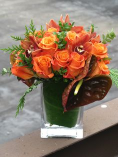 Vibrant oranges and deep burgundies offset by sprigs of green make this the perfect fall centerpiece or flower arrangement Halloween Flower Arrangements, Halloween Flowers, Floral Centerpieces, Floral Arrangements, Centerpiece Ideas, Fall Flowers, Wedding Flowers, Deep Burgundy, Orange Roses