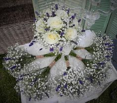 Bridal bouquet with bridesmaids posies. Gypsophilia roses and lavender
