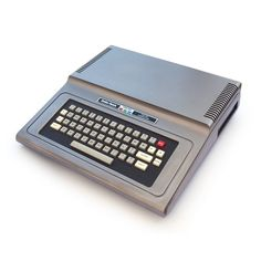 The RadioShack Color Computer is a line of home computers based on the Motorola 6809 processor. The Tandy Color Computer line started in 1980 with what is now called the CoCo 1 and ended in 1991 with the more powerful CoCo Micro Computer, Home Computer, Gaming Computer, Computer Keyboard, Computer Science, Online Pc Games, 8 Bits, Computer Hardware, Desktop Computers
