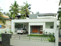This is an astounding example of contemporary home design. Influence of straight and clean lines can be seen in the entire structure. Exterior walls are painted in white. The compound is semi-open. The house is designed in such a way that it won't asphyxiate in this small plot.  Tags: @Contemporary @Home Designs, 3000 Sq Feet Home, @interior @hughhuddleson @kerala @home @design