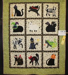"""Meow-Squerade Ball - Kayla Coale, hand quilted.  Design by Judi Maxwell at Jukebox Quilts (""""Buster Cat Does Halloween"""").  Photo by Barbara Robson"""