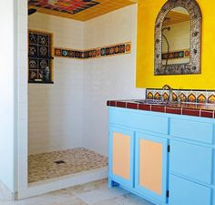 Mexican tile is the perfect fit for the southwest colors in this bathroom and shower.