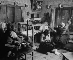 The Weavers, Sirbi, 2000. In summer the family loom lies jumbled in the barn like a heap of broken scythe handles. But in winter, it is time for women to maintain the familys supply of woven wealth, and for a young woman to begin creating her dowry. The loom takes shape in the family living space and its shuttle again flies for hours a day. © Kathleen Laraia McLaughlin.