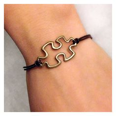 Brown leather with Brass Puzzle Piece Autism Awareness Charm Bracelet, Wedding Day, Anniversary, Birthday Gift, Adjustable wish bracelet. $6.50, via Etsy.