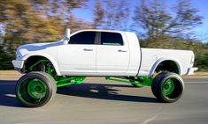 All white gen Ram mega cab short box lifted with green accoutrements Lowered Trucks, Jacked Up Trucks, Dodge Trucks, Cool Trucks, Big Trucks, Pickup Trucks, Lifted Cummins, Cummins Diesel Trucks, Dodge Cummins