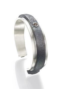 Robert Grey Kaylor | Steel nail with brown diamond cuff | Max's