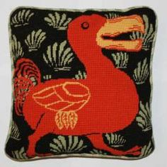 The Dodo bird needlepoint pillow--made in a London prison by Fine Cell Work--teaching inmates useful skills