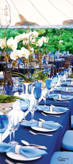 cobalt linens, silver accents, cobalt glassware, simple florals