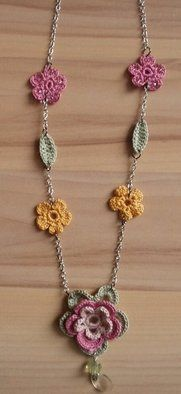 Chrochet Flower Necklace. I've been looking for a dainty one.  This will do nicely!  pjc