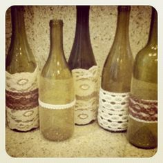 wine bottles I covered with vintage lace and tulle. Would make cute center pieces