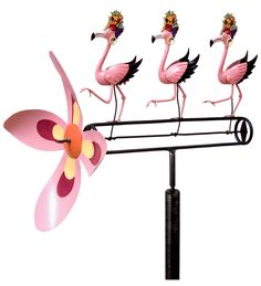 Carmen Miranda Dancing Pink Flamingos Wind-Powered Whirligig - watch the video - their butts wiggle!!!  LMAO Have to get this for my Mom