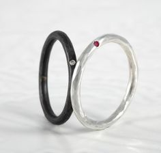 Dainty hammered rings set with gemstones. Oxidised silver with diamond, and polished with ruby. £68