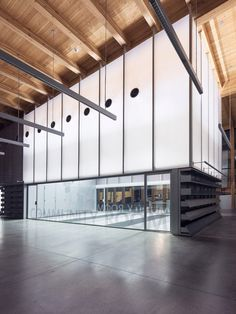 """""""The shift in geometry of the facade orients the new entry of the library toward the town square across the street, and allows the new entry to be visible from the center of the village,"""" Berman said."""