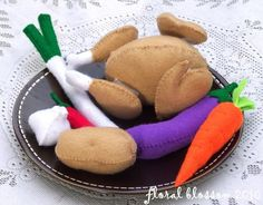 felt food- - Whole chicken (removable legs and wings) - Chilli - Carrot - Eggplant - Potato - Spring Onion - Garlic