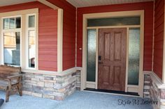 house exterior, countrylane red hardieplank, hardieboard with stacked stone, tan trim, beige windows and oak front door