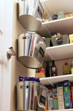 Metal storage bins are very inexpensive and they make great organization solutions. Just nail or screw them to the wall and label so that you know what should go inside. You can use these in your pantry to keep snacks and other foods separated or put them right on the kitchen wall for utensils, bags or other items. Via: Lilblueboo - Hanging Metal Storage Bins (A Tutorial)