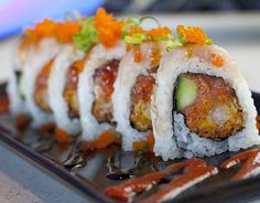 Mikuni Midtown Roll- Cucumber, spicy tuna, panko shrimp, garlic white tuna, sauce, masago and onion