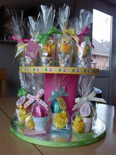 DIY cake stand with Easter eggs in hand painted plant pots.  Sold like hot cakes at infant school fayre