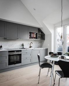 A beautiful grey and marble kitchen dining space - Is To Me