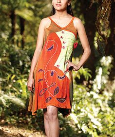 Bodaciously bohemian, this darling dress brings breezy elegance to laid-back looks. Boasting bright bursts of color and enchanting embroidery, this handcrafted frock radiates romantic, earthy appeal. Note: Because this piece is completely handmade, colors may differ dramatically from what is pictured.