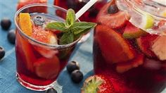 Sangria, a traditional Spanish drink made with wine, fruit and a sweetener, is a classic summer refreshment. To make sangria, soak sliced fruit like strawb Sangria Punch, Watermelon Sangria, Sangria Drink, Peach Sangria, White Sangria, Moscato Sangria, Cranberry Sangria, Carlo Rossi Sangria, Thanksgiving Sangria