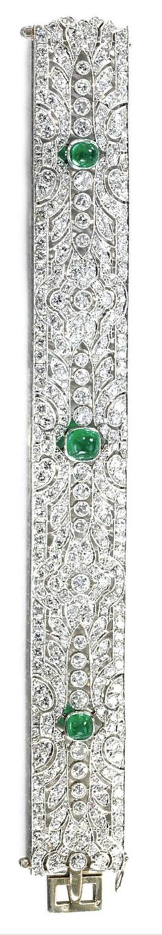 EMERALD AND DIAMOND BRACELET,  CIRCA 1920.  The articulated band of open work design, set throughout with circular- and single-cut diamonds, highlighted by three millegrain-set cabochon emeralds, French assay marks, numbered,