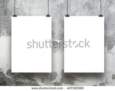 Close-up of two blank frames hanged by clips against grey scratched concrete wall background