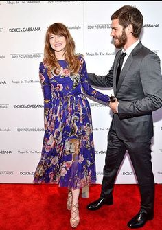 Emma Stone, in a floaty floral frock, was all smiles with boyfriend Andrew Garfield at the premiere of Magic in the Moonlight     Courtesy: usmagazine.com   #StudioSuits #StudioSuitsShirts #StudioSuitsTrousers #customclothing #StudioSuitscustomclothing  For more visit our Facebook Page at http://on.fb.me/1pPxBaX Order from our website: http://www.studiosuits.com/