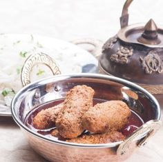 Kashmiri Mutton Koftas Recipe - A popular recipe from the cuisine of Kashmiri Pandits, the koftas are midly spices and simply melt on your tongue.