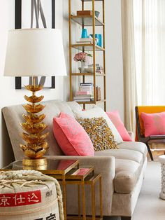Trendy gold accents add fresh style to this eclectic living room. See more decorating trends: http://www.bhg.com/decorating/lessons/expert-advice/decorating-trends/?socsrc=bhgpin051813goldaccents=3