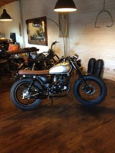 Love the bike, love the exposed brick and old wood floors... want, want, want...