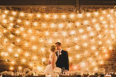 A beautiful indoor wedding in Ann Arbor at Zingerman's restaurant with the most beautiful twinkle lighting display backdrop!