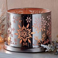 "ENCHANTED WINTER SNOW VOTIVE HOLDER : Create a magical snow shower with glistening photo-etched metal snow flakes illuminated by candlelight. Metal holder with glass votive cup for votives or tealights, sold separately. 4¼""h, 5¾""dia. by PartyLite www.partylite.biz/partylite.biz"