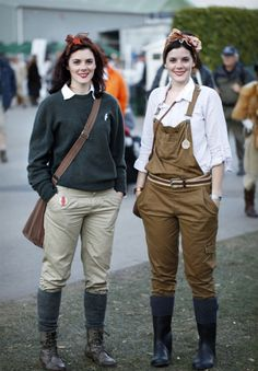 Two attendees of The Goodwood Revival in Sussex channel the Land Girl style