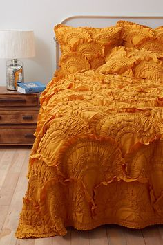 Rivulets Quilt, Gold: Made of puckered cotton jersey. #Quilt #anthropologie