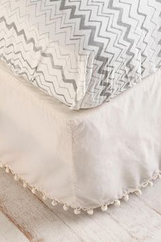 pom pom bedskirt - think I should try and make this to hide all the crap under our bed!