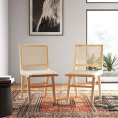 Bring some boho-coastal vibes to your next Thai-takeout Tuesday with these dining chairs. Made from solid ash wood in a natural finish, these chairs are supported by four angled legs with supportive crossbars that add some extra style. The seat and full back have a cane finish for some retro boho vibes. Thanks to their armless design, you can tuck these chairs right up to your dining table to create a streamlined look. What we really love is that they arrive fully assembled. Sold in sets of… Cane Dining Chairs, Decor, Dining Chairs, Side Chairs, Furniture, Chair, Chair Set, Upholstered Side Chair, Solid Wood Dining Chairs