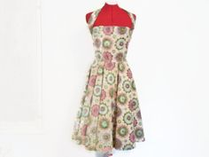 Late 1950s or early 1960s era sexy full-skirted dress--Ill bet this dress has been worn to some fabulous dances in its day. Would make a fun outfit for a retro event! Features a back meal zipper, fitted bodice and Marilyn Monroe style neck strap, and a heavy parchment-like lining to give body to the full, circle skirt. Tagged Alex Coleman.  Condition: I do see some small rusty stains that are probably permanent, most notably on the front bodice (see photo 5). All are very small and unlikely…