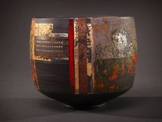 Tony Laverick's luminous pots, made in black and translucent porcelain, combine fields of vivid and more austere colours, geometric precision of line with freer decoration. Their often complex geometry adds life and movement to form, the different colours often overlaid to give a sense of depth and synergy.