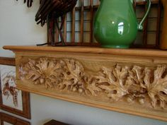 http://www.jerrymifflinwoodcarving.com/Grist%20Mill%20Mantel_Finished_Installed_Left.jpg