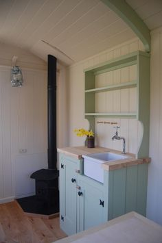 Belfast sink,dresser and daffodils in a Plankbridge hut
