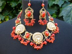Gold African Head and Coral Necklace Set for Hire (UK only) £85 including postage. Contact akinulic@aol.com
