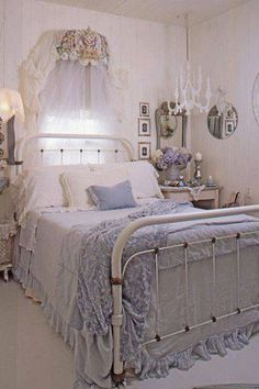 Gorgeous bedroom- love the wood chandy and the bling on the bed crown.