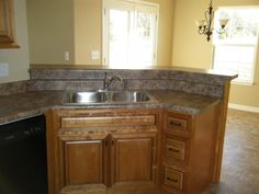 Amber With Black Pen Glaze Kitchen Cabinets. Sink Base, Raised Bar Top And  Butterum
