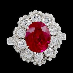 Platinum Diamond & Oval Shape Ruby Ring. Ruby 3.96cts. & Diamond 1.13cts.