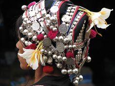 Laos | The elaborate headdress of the Akha women.  Here she has also added fresh flowers. | © Roland Engelhofer.